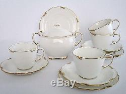 Set of 4, Royal Crown Derby England Bone China White Regency Tea cups & Saucers